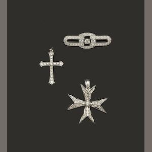 A diamond bar brooch and two diamond pendants (3)