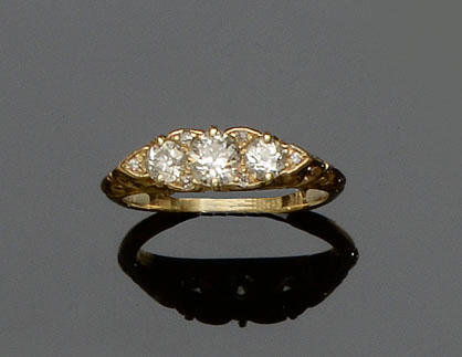 An early 20th century diamond half hoop ring