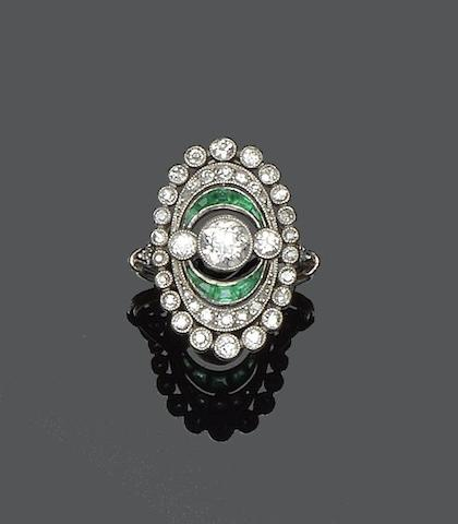An early 20th century diamond and emerald panel ring