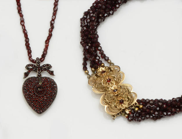 A garnet pendant and a garnet multi-strand necklace  (2)