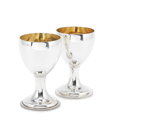 A matched pair of George III silver goblets one by Stephen Adams, London 1808, the second by Charles Wright, London 1778  (2)