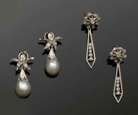 A pair of cultured pearl and diamond earrings and a pair of diamond pendent earrings (2)