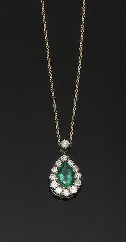 A diamond and emerald cluster pendant