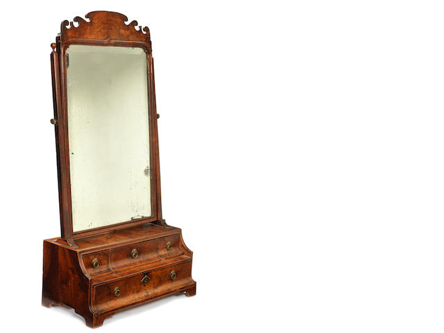 A George I walnut fret carved swing frame toilet mirror