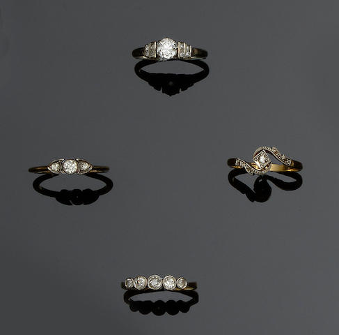 A diamond single stone ring and three further diamond rings (4)