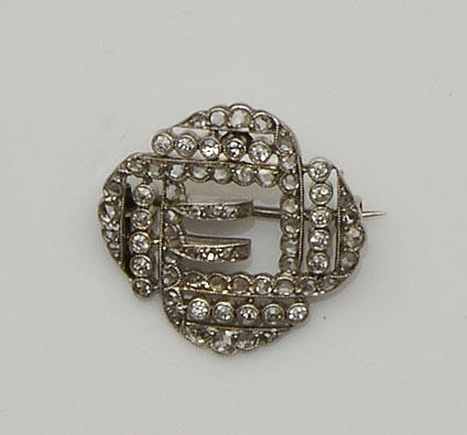 A diamond buckle brooch