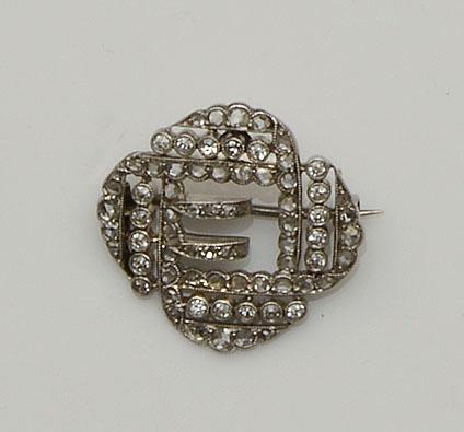 A diamond buckle brooch