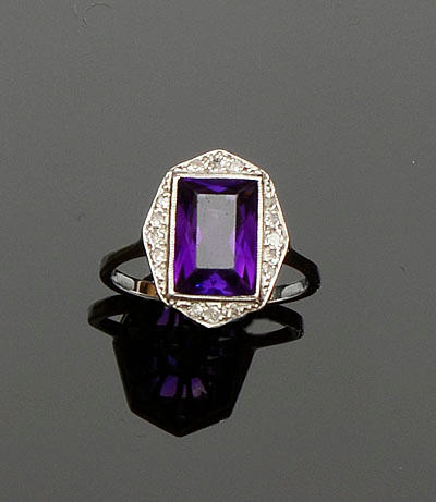 An amethyst and diamond panel ring