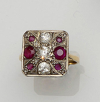 A ruby and diamond panel ring