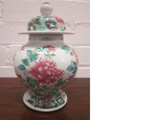A Chinese famille rose baluster vase and cover, late 18th/early 19th century, decorated with flowers and butterflies