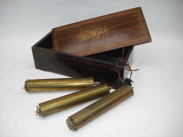 Three musical box cylinders and musical box case:
