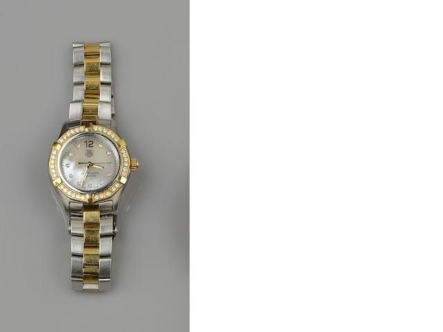 TAG Heuer: A lady's Aquaracer stainless steel wristwatch
