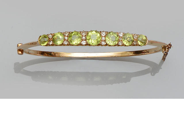 A peridot and diamond bangle