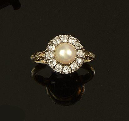 A cultured pearl and diamond cluster ring