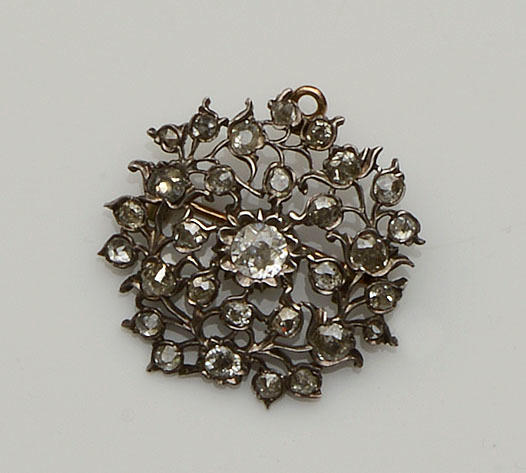 A diamond cluster brooch