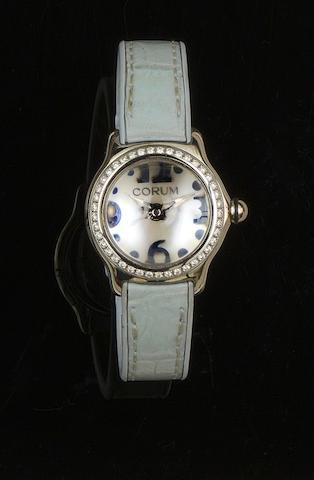 Corum: A lady's diamond set wristwatch