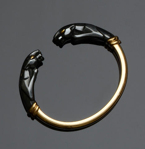 Cartier: An 18ct gold and hematite torque bangle
