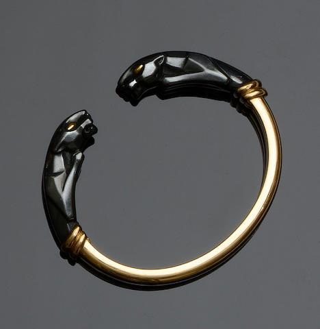 Cartier: An 18ct gold and hematite torque bangle