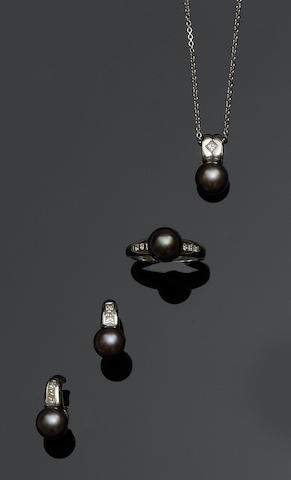 A cultured pearl and diamond pendant, ring and earrings suite (3)