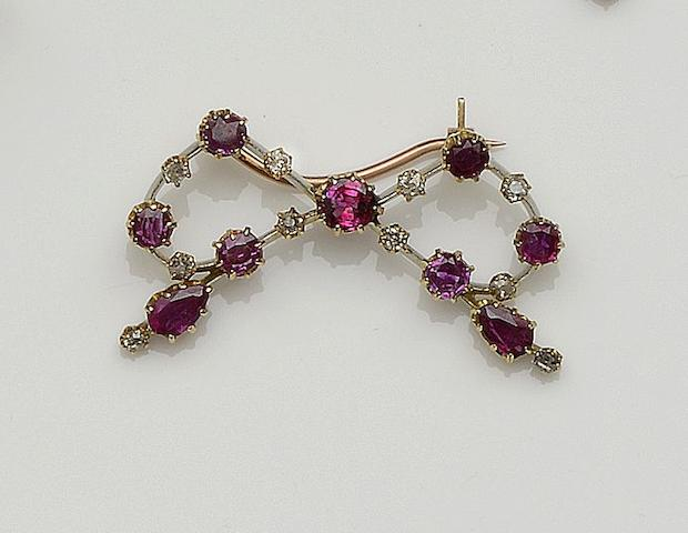 A ruby and diamond bow brooch