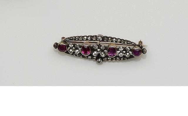 A ruby and diamond bar brooch
