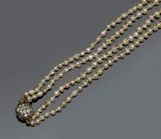 A pearl and diamond long necklace