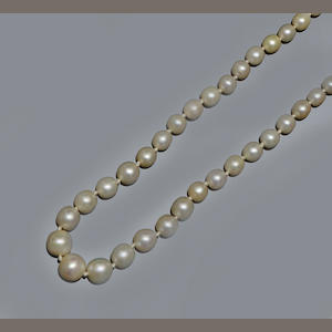A graduated pearl and diamond necklace