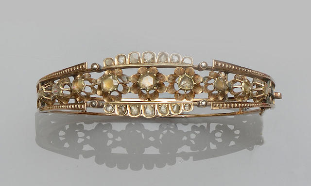 A diamond set hinged bangle