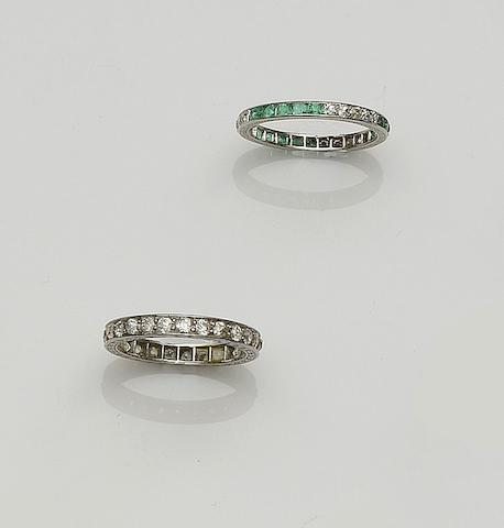 An emerald and diamond full hoop eternity ring and a diamond full hoop eternity ring (2)