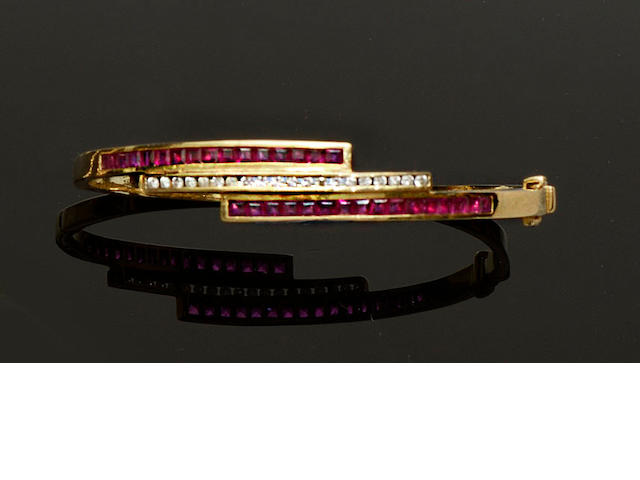 A ruby and diamond crossover bangle