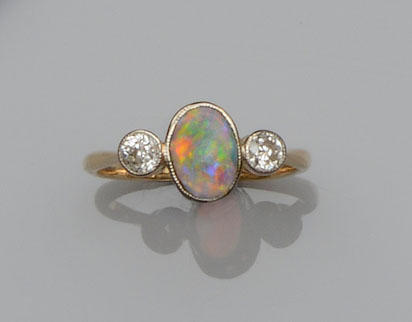 An opal and diamond three stone ring