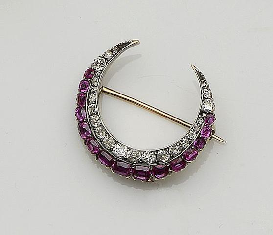 A ruby and diamond crescent brooch,