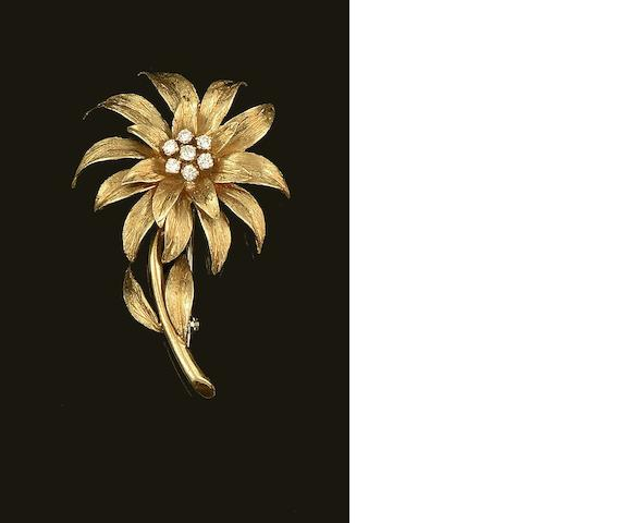 An 18ct gold diamond set flower brooch