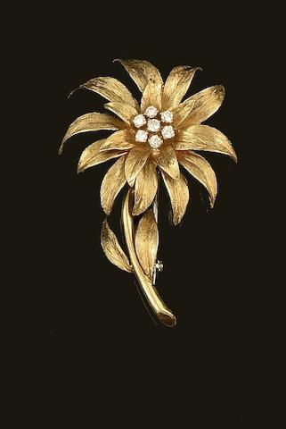 An 18ct gold diamond set flower brooch