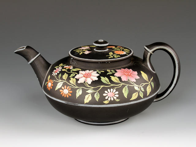 A Wedgwood enamelled basalt teapot and cover, circa 1820