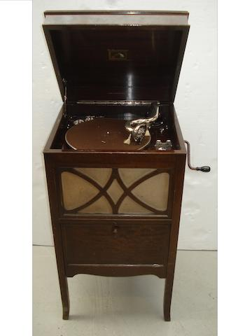 An HMV Model 145 gramophone,