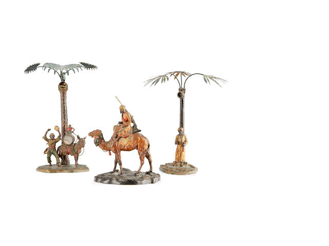 Two first half 20th century cold painted spelter lamp bases together with a similar group