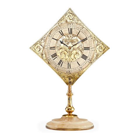 A late 19th century brass timepiece in the 18th century style