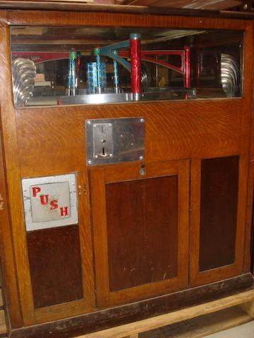 A large four-player prize-pusher coin-operated console, circa 1930