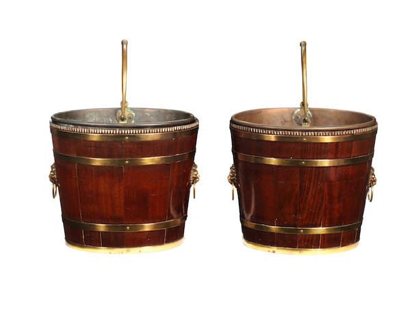 A rae pair of Geo III oval mahogany buckets with flute carved tops. Later copper liners. Prov Sir Sydney Barratt, Summerhill, Staffs