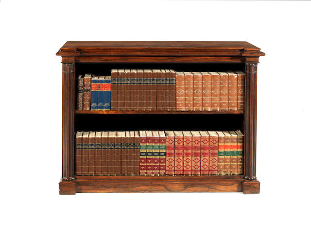 A William IV rosewood carved low open bookcase  by W.Constantine & Co of Leeds