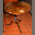 An early 19th century oak, tilt-top tripod table