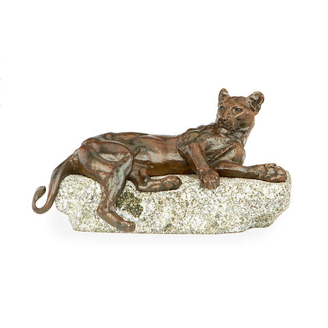 An early 20th century bronze model of a lioness