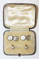 An Omega wristwatch and a small dress set (2)
