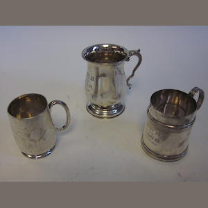 A silver christening mug, in the 18th century manner by Thomas Bradury & Sons Ltd, Sheffield 1926 two other silver christening mugs, Birmingham 1919 and London 1877, and other silver items (Qty)