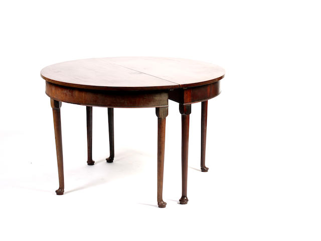 A George II style mahogany D-shaped dining table