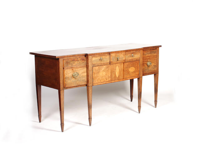 A late George III mahogany and inlaid break-front sideboard