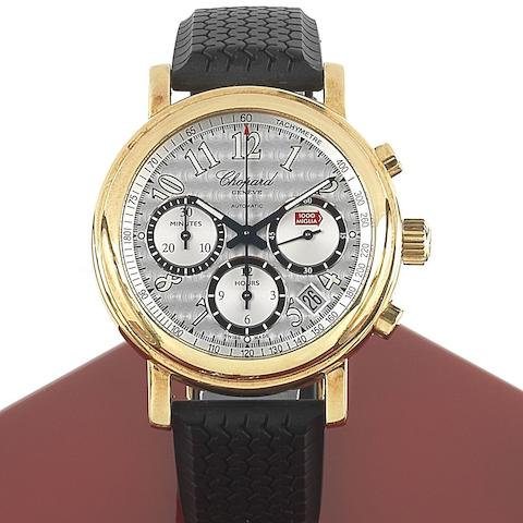 Chopard. An 18ct gold automatic calendar chronograph wristwatchMille Miglia, Ref:1250, Case No.709733, Circa 1999