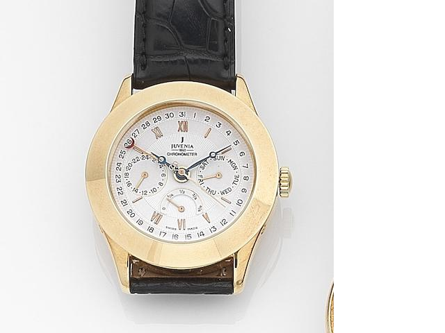 Juvenia. An 18ct gold automatic calendar wristwatch with second time zone and power reserve indicator  Ref:9679, Case No.1353361, Numbered 064/150, Circa 2000