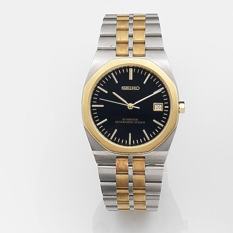 Seiko. A stainless steel and gold automatic quartz calendar bracelet watch Ref:522-8A30, Case No.287235, Circa 1990